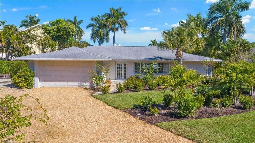 SANIBEL Real Estate - View SW FL MLS #220010744 at 1560 Royal Poinciana Dr in WATER SHADOWS UNRECORDED SUBDIVISON at WATER SHADOWS UNRECORDED SUBDIVISON