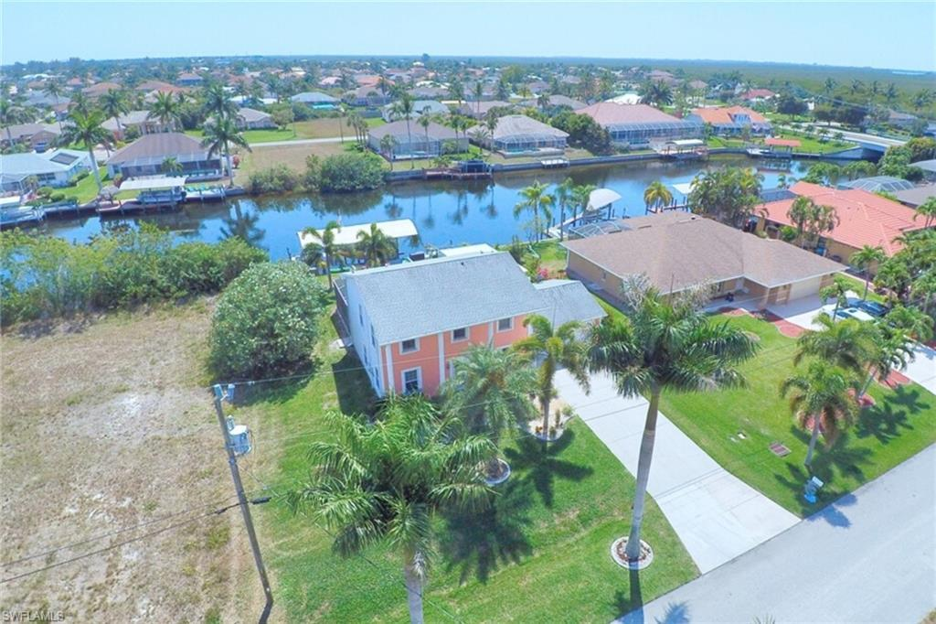 SW Florida Real Estate - View SW FL MLS #220023592 at 2840 Sw 36th Ter in CAPE CORAL in CAPE CORAL, FL - 33914