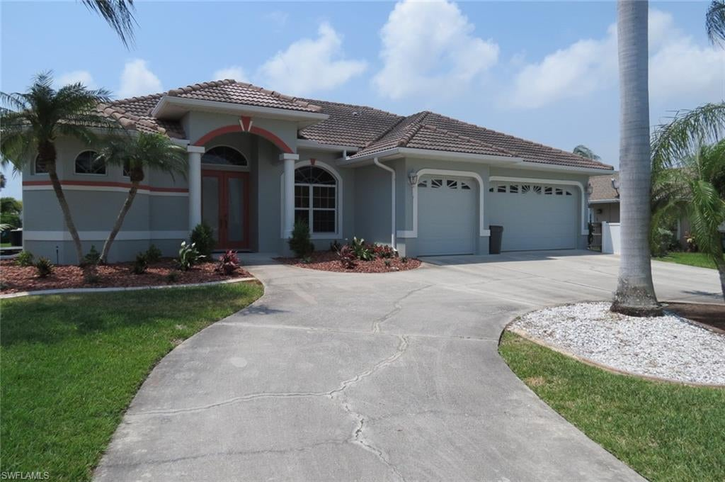 CAPE CORAL Real Estate - View SW FL MLS #220025704 at 5016 Sw 8th Pl in CAPE CORAL in CAPE CORAL, FL - 33914