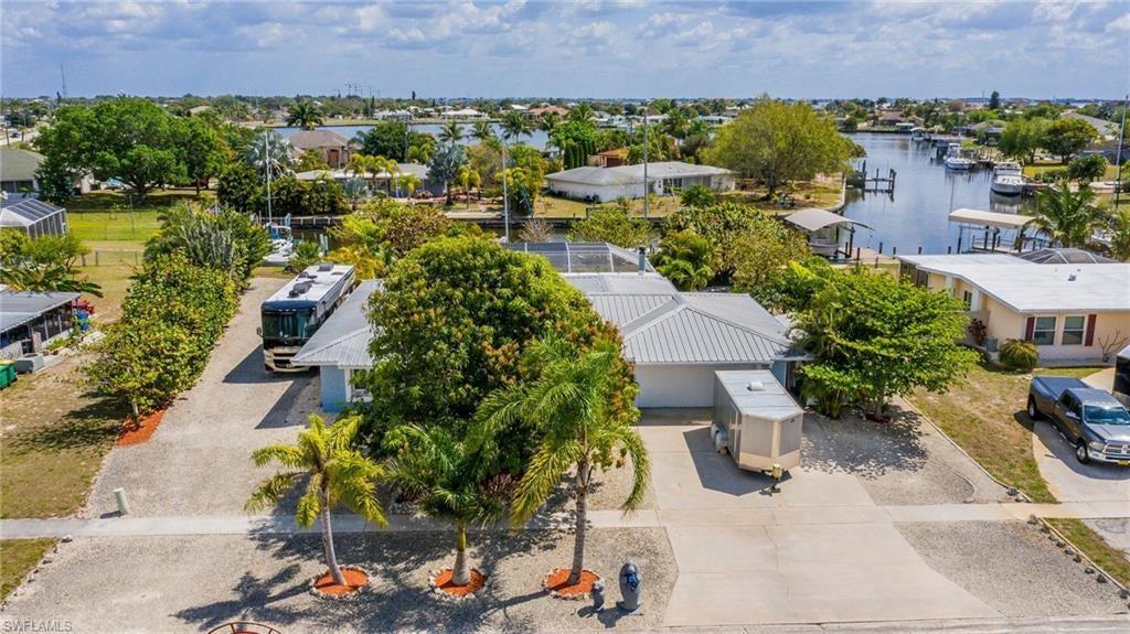 SW Florida Home for Sale - View SW FL MLS Listing #220032570 at 105 Cousley Dr Se in PORT CHARLOTTE, FL - 33952
