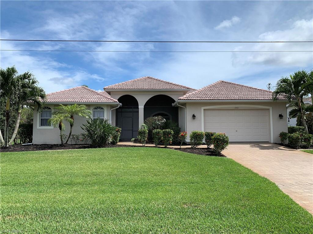 SW Florida Real Estate - View SW FL MLS #220033320 at 2360 Coral Point Dr in CAPE CORAL in CAPE CORAL, FL - 33990