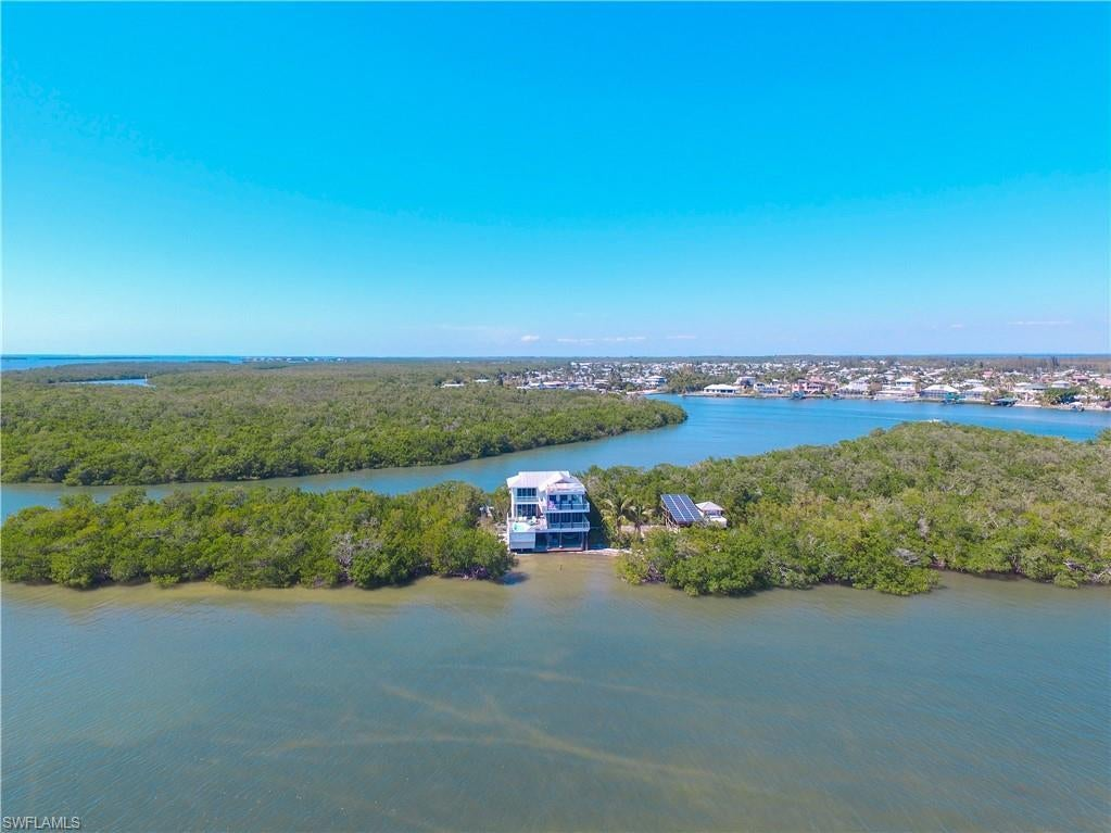 SW Florida Home for Sale - View SW FL MLS Listing #220033458 at 1 Cres Island in SANIBEL, FL - 33957