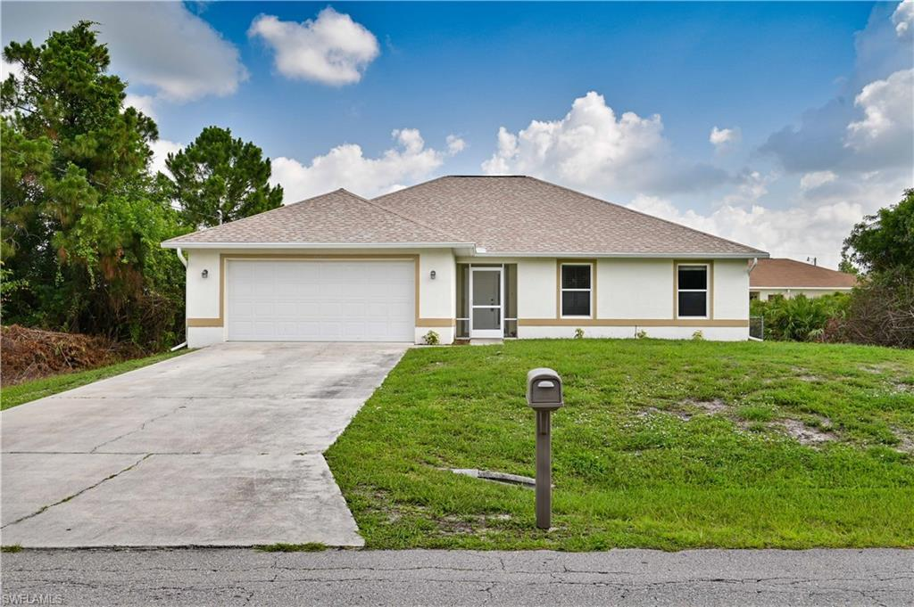 SW Florida Home for Sale - View SW FL MLS Listing #220034596 at 2612 19th St W in LEHIGH ACRES, FL - 33971