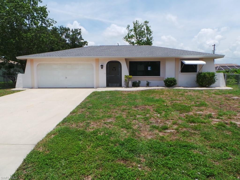 SW Florida Real Estate - View SW FL MLS #220002896 at 921 Se 32nd Ter in CAPE CORAL in CAPE CORAL, FL - 33904