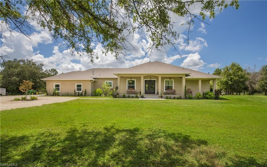 SW Florida Real Estate - View SW FL MLS #220049242 at 18501 Green Meadow Rd in FORT MYERS in FORT MYERS, FL - 33913