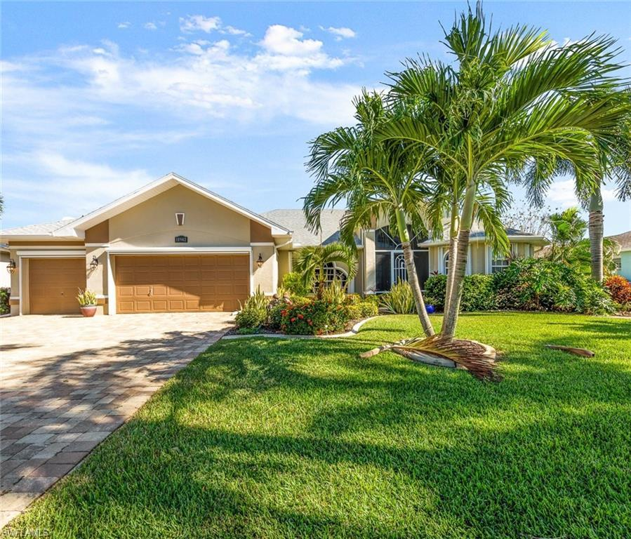 SW Florida Real Estate - View SW FL MLS #220074879 at 11942 Royal Tee Cir in CAPE ROYAL in CAPE CORAL, FL - 33991